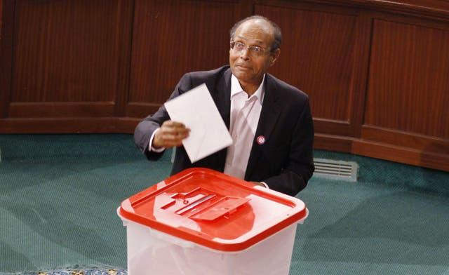 Tunisia installs former dissident Moncef Marzouki as president