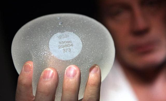 French breast implant tycoon hits back as scandal grows