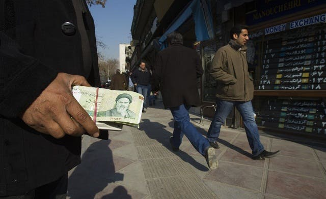 Iran's rial drops 10 percent as EU bans oil imports