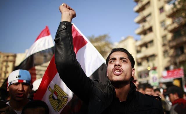 Egypt slaps travel ban on U.S. NGO staff, Washington urges lifting ban 'immediately'