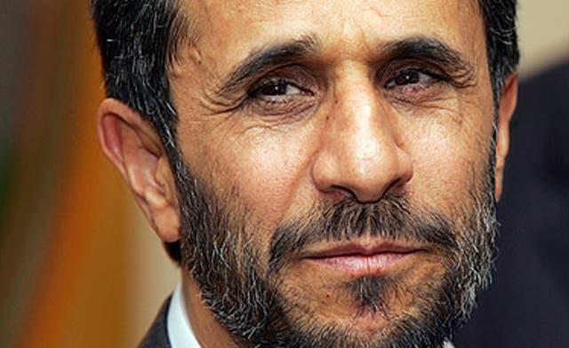 Iran's parliament summons Ahmadinejad on economic policy