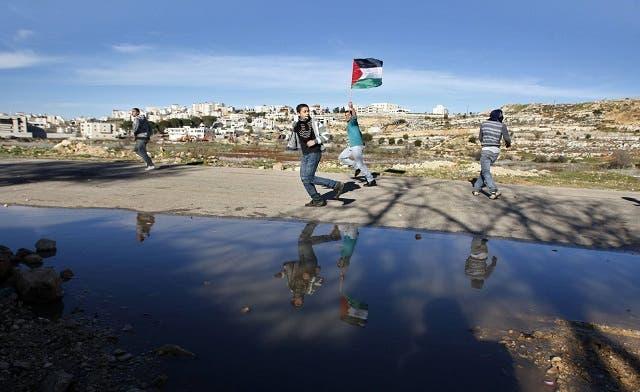 Palestinian Authority, battling debt crisis, raises taxes