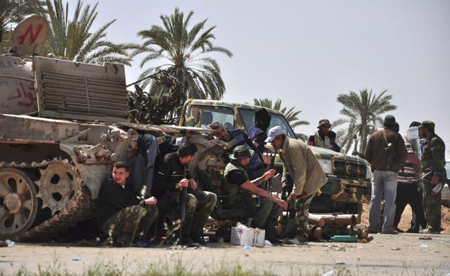 Fresh clashes erupt in western Libya between former rebels, killing 26