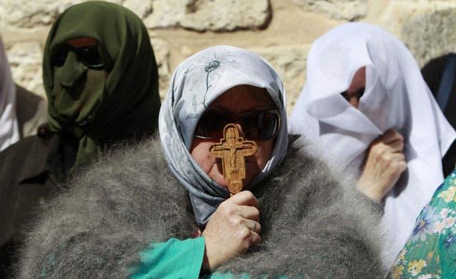 Christian pilgrims gather in Jerusalem for fire ritual