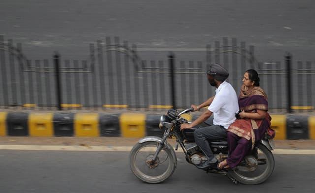 Delhi helmet law takes deadly toll on women