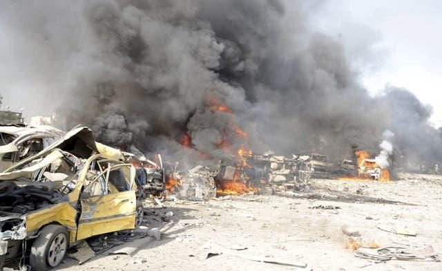 Syrian troops pound Rastan as U.N. team brokers swap between regime, rebels