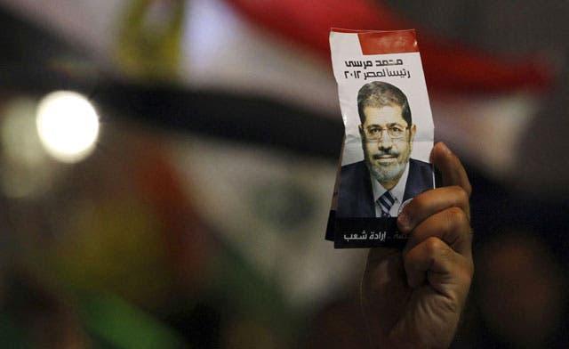 Brotherhood says Mursi no longer a member but embraces him as president of Egypt