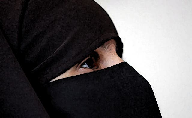 Muslim mother banned from British school over face veil