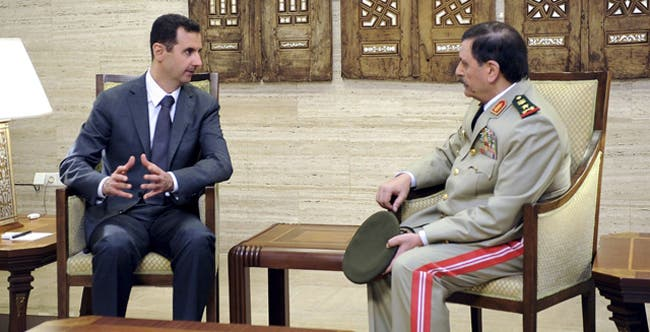 Russia says Assad ready to step down in 'civilized manner,' Syria denies