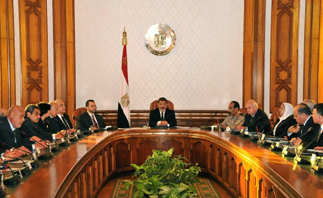 Egypt's president swears in new Cabinet; Tantawi to remain defense minister