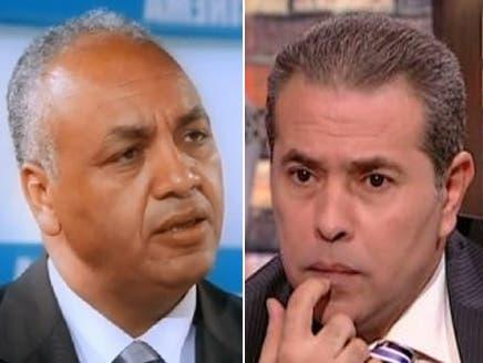 الإخوان يتهمون بكري وعكاشة بالتحريض على حرق مقارهم