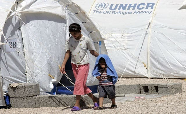 Syrian refugees move to camp set up for them in Iraq