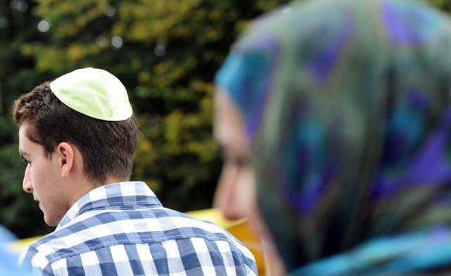 France's Le Pen calls for ban on Muslim headscarf, Jewish kippah