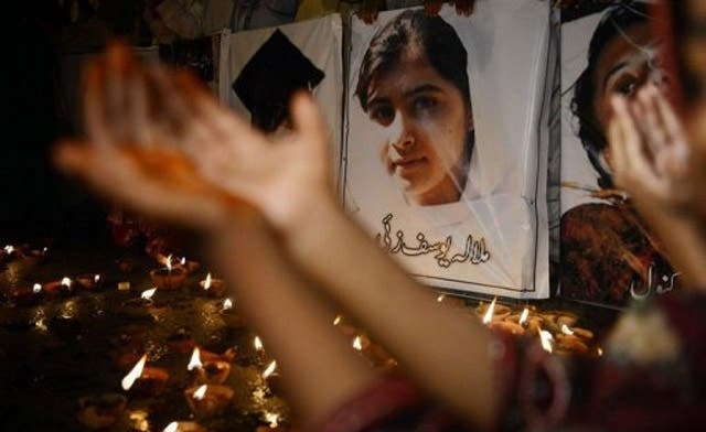 Afghan students pray for schoolgirl, Malala, shot in the head by Taliban