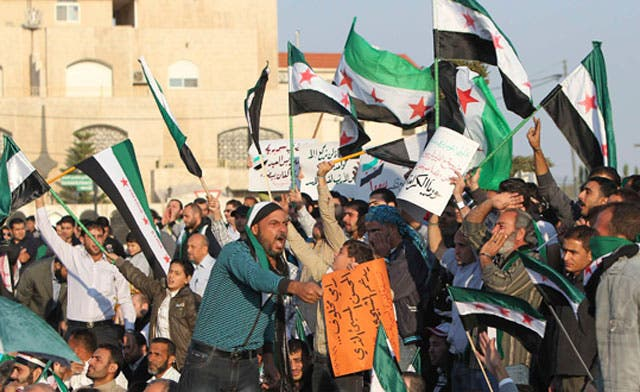 Activists report killings on truce day as Syrians protest against regime