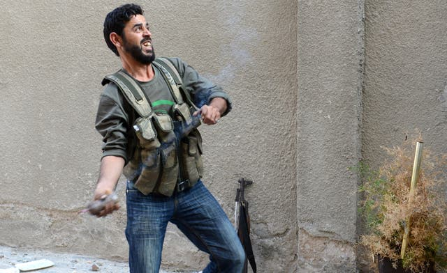 Syria rebels clash with army and Palestinian fighters