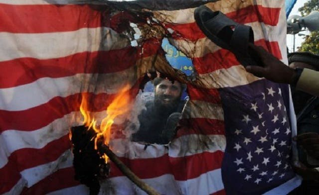 Flags on fire: Obama win may be good news for Pakistan flag-makers