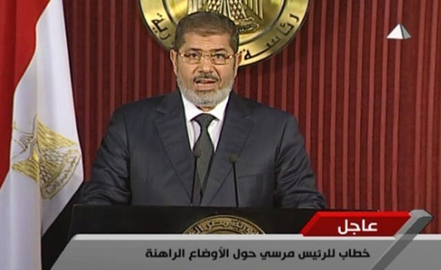 Egypt's Mursi calls for dialogue, makes concession to opponents