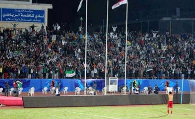 Syrian footballer raises revolution flag in official match