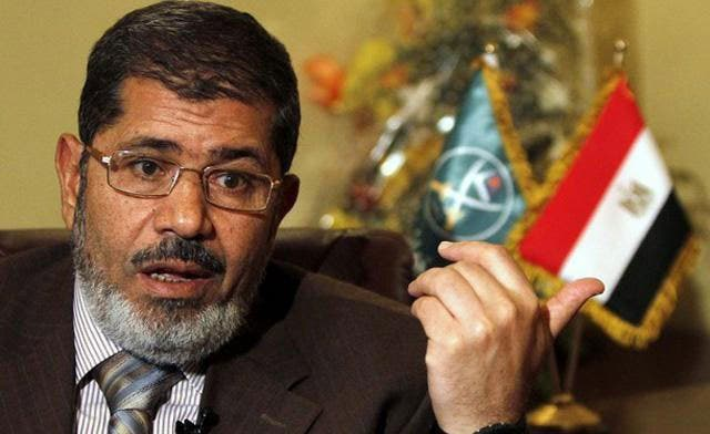 Egypt's Mursi backs calls for Assad war crimes trial