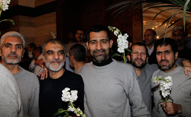 Iranians freed by Syrian opposition fighters arrive in Damascus hotel